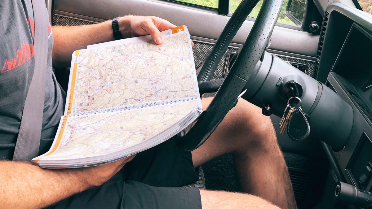Rob Nelson Looking at a map in car
