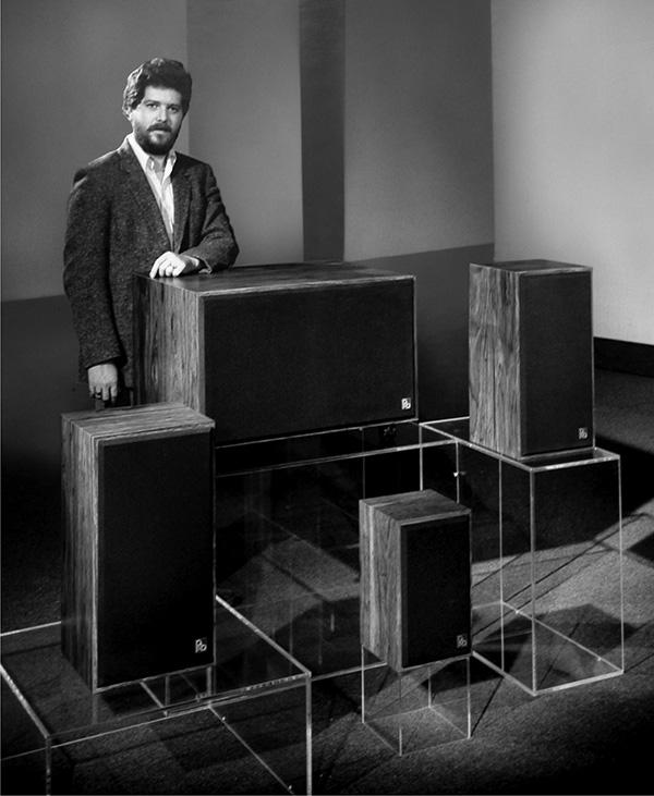 Paul Barton standing beside his speakers in 1975